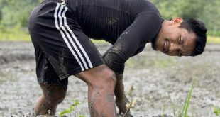 During off-season, midfielder Len Doungel delighted to assist in family's paddy field!